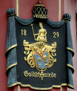 an ornate historic building sign for a goldsmith