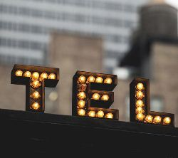 old fashion channel letters with light bulbs