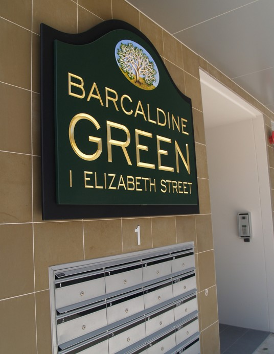Barcaldine Green Apartment Sign with mailboxes