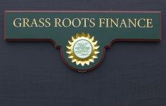 Grass Roots Finance Business Sign