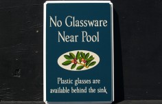 No Glassware near Pool Bar Sign