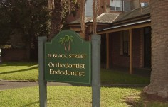 21 Black Street Orthodontist Sign
