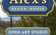 Alex's Beach House Sign with subsigns