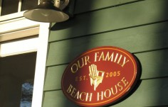 Our Family Beach House sign on site
