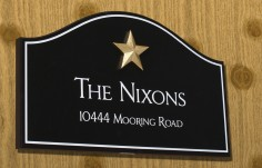The Nixons House Sign