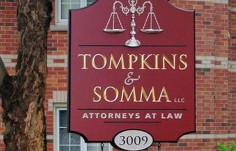 Tompkins & Somma Law Office Sign